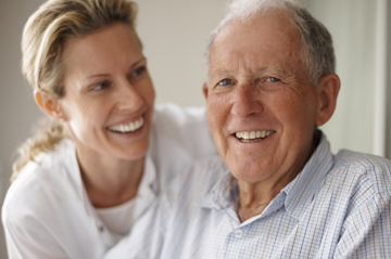 smiling man with caregiver