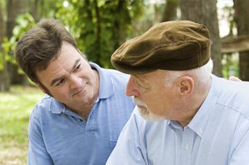 man and elder talking outside