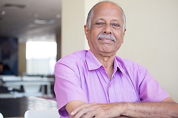 Older man smiling indoors