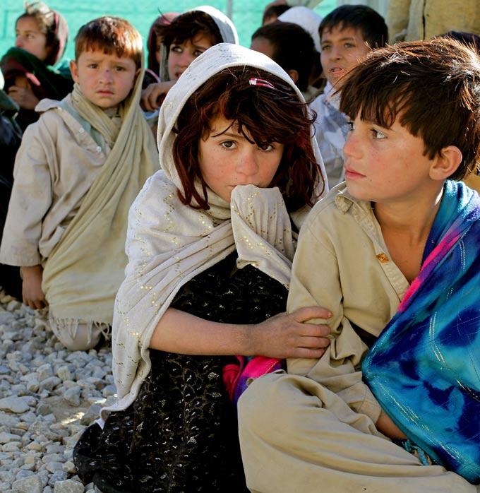 refugee children sitting together